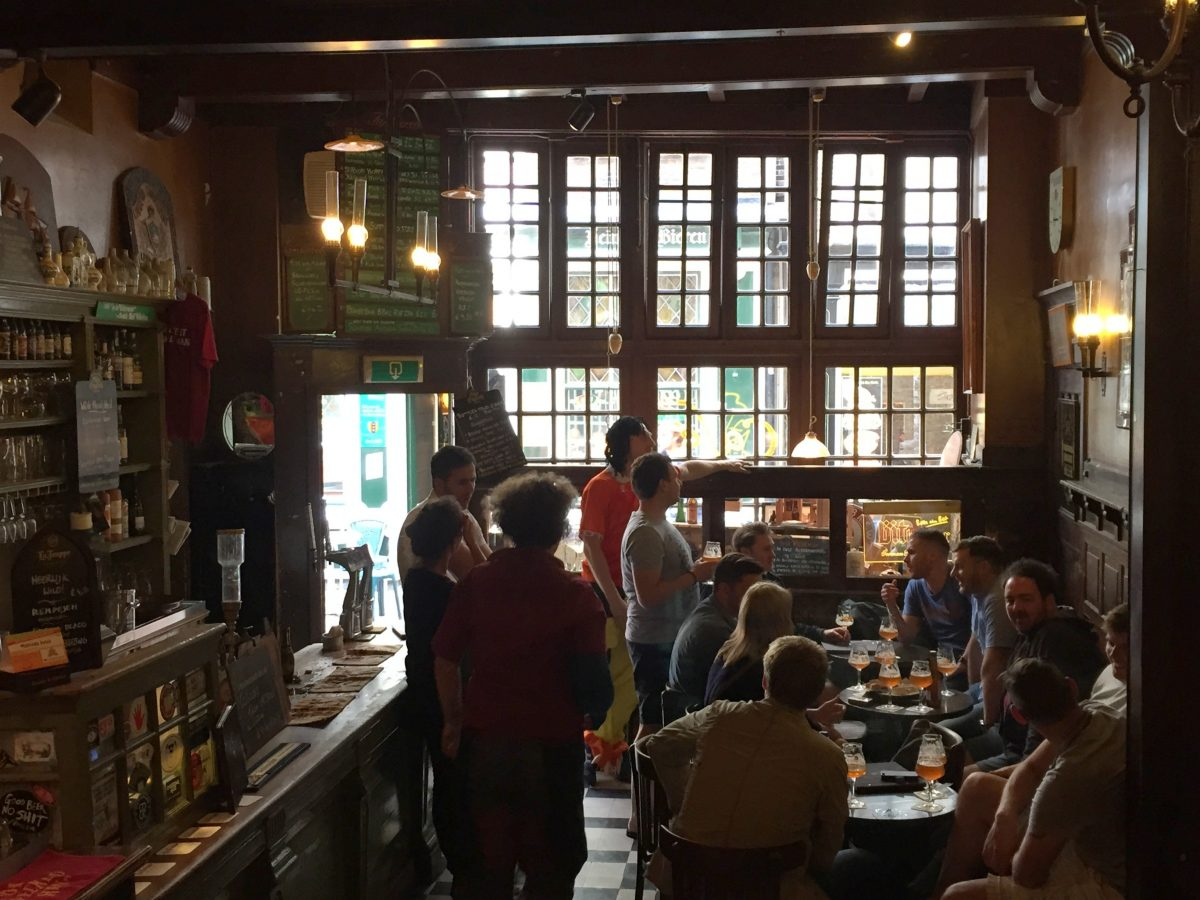 In De Wildeman has 200 types of bottled beers and nearly 20 beers on tap. Located in a historic distillery, this two-room bar has plenty of tables where you can sit and chat with friends over Belgian, Dutch, German, or British beer.