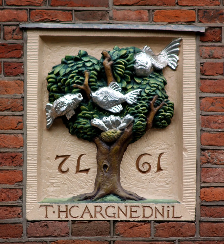 This gevelsteen in Amsterdam is one of the newer ones, although it looks old. It has fish in a tree that refers to an upside down world. It commemorates the filling in of the Lindengracht canal.