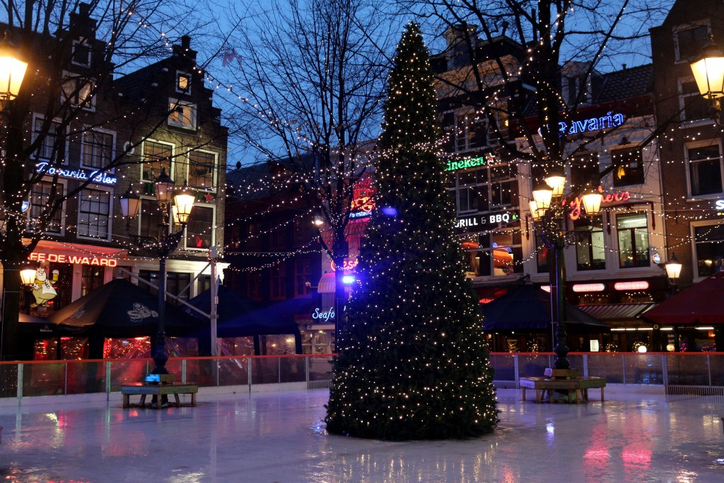 Luckily there are ice skating rinks in Amsterdam where you can strap on your skates for a spin on the ice like this one at Leidseplein.